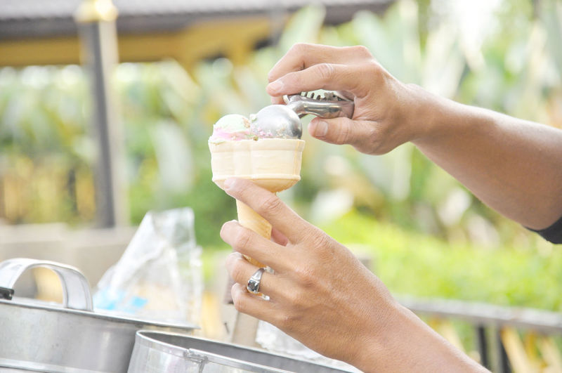 man preparing scope ice cream to cone Adult Adults Only Close-up Cone Day Food And Drink Freshness Hawker Holding Human Body Part Human Hand Ice Cream Ice Cream Cone Leisure Activity Outdoors Park People Scope