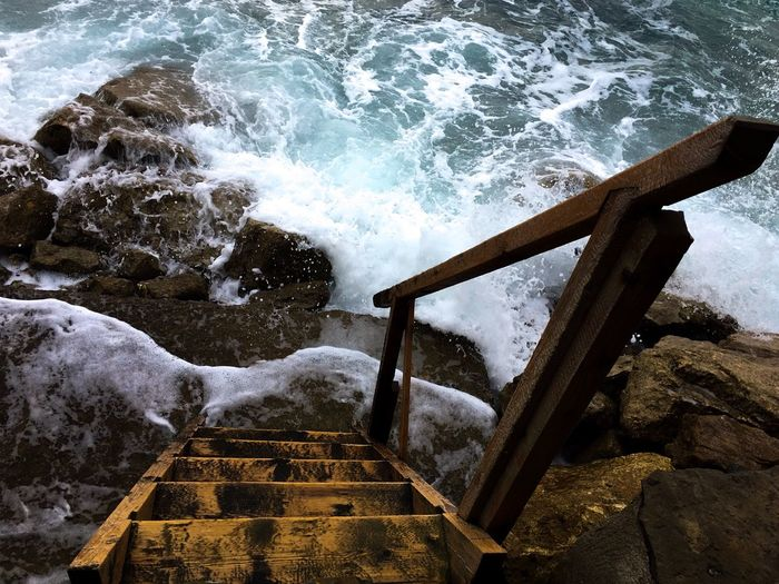 High angle view of steps in sea