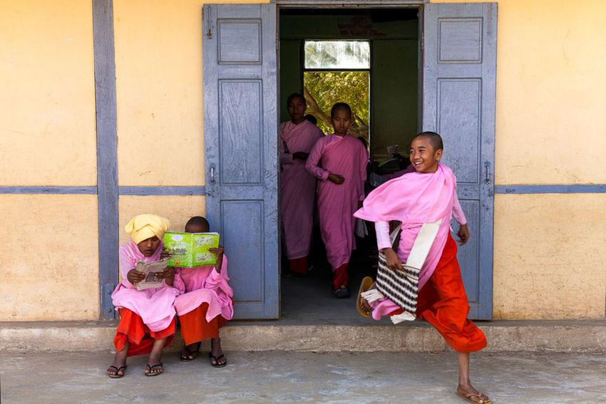 Young nuns at school near Mandalay, Myanmar. Atmosphere Buddhism Buddhist Built Structure Burma Childhood Children Documentary Friendship Fun Girls Happiness Happy Kids Leisure Activity Lifestyles Mandalay Moment Motion Myanmar Nuns School School Life  Smile Travel