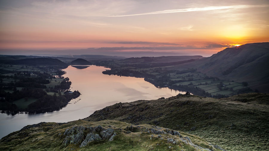 Sunrise over Ullswater Lake District National Park UNESCO World Heritage Site Ullswater Beauty In Nature Cloud - Sky Environment Idyllic Landscape Mountain Nature No People Non-urban Scene Orange Color Outdoors Rock Rock - Object Scenics - Nature Sky Solid Sun Sunrise Sunset Tranquil Scene Tranquility Water