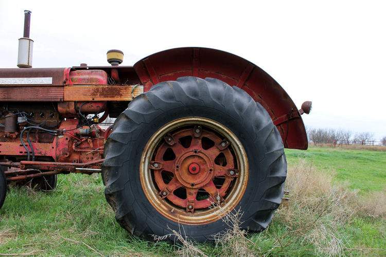 Old Tractor On Grassy Field