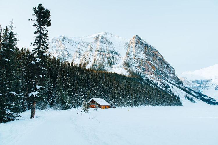 Tilt image of house against sky during winter