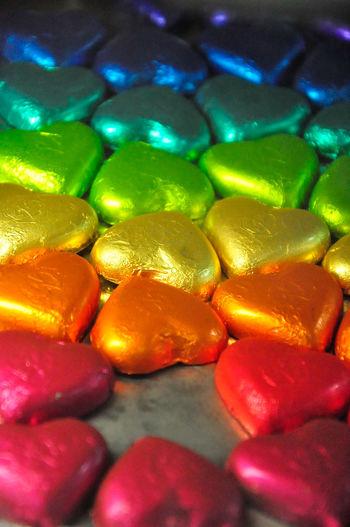 Close-up of multi colored heart shape desserts