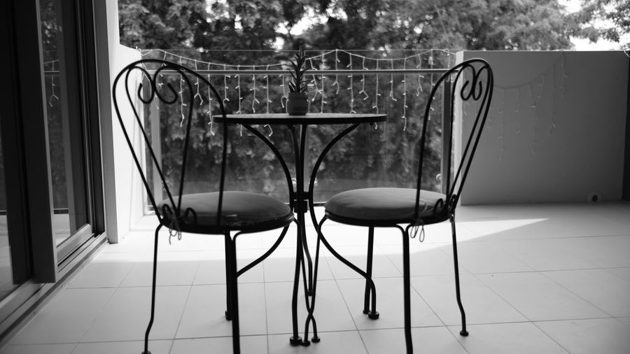 Balcony Balcony View Black & White Black And White Blackandwhite Blak And White Brisbane Chair Cold Temperature Day Fujifilm Monochrome No People Outdoor Outdoor Furniture Outdoors Tree
