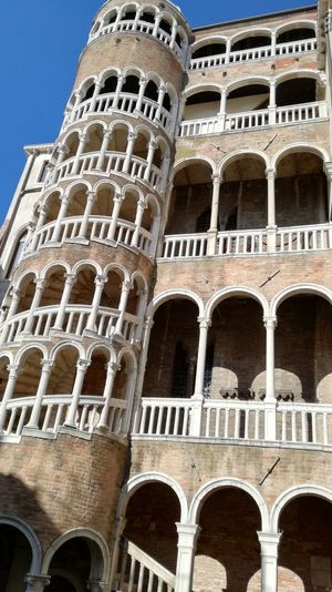 Venezia Ancient Architectural Column Architecture Building Building Exterior Built Structure City Day Escalier En Colimaçon Low Angle View No People EyeEmNewHere My Best Travel Photo A New Beginning