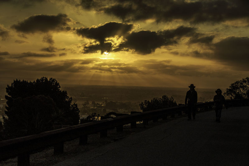 Beauty In Nature Cloud - Sky Cloudy Couple Dramatic Sky Idyllic Leisure Activity Lifestyles Man With Hat Morning Nature Older Couple Outdoors Scenics Silhouette Sky Sun Sunrise Sunset Tranquil Scene Tranquility Walking Woman With Style