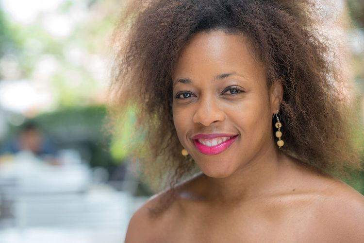 Smiling African-American woman. African-american EyeEm Selects Headshot Portrait Hairstyle Hair Curly Hair Women One Person Smiling Young Adult Looking At Camera Front View Young Women Lifestyles Adult Beauty Beautiful Woman Real People