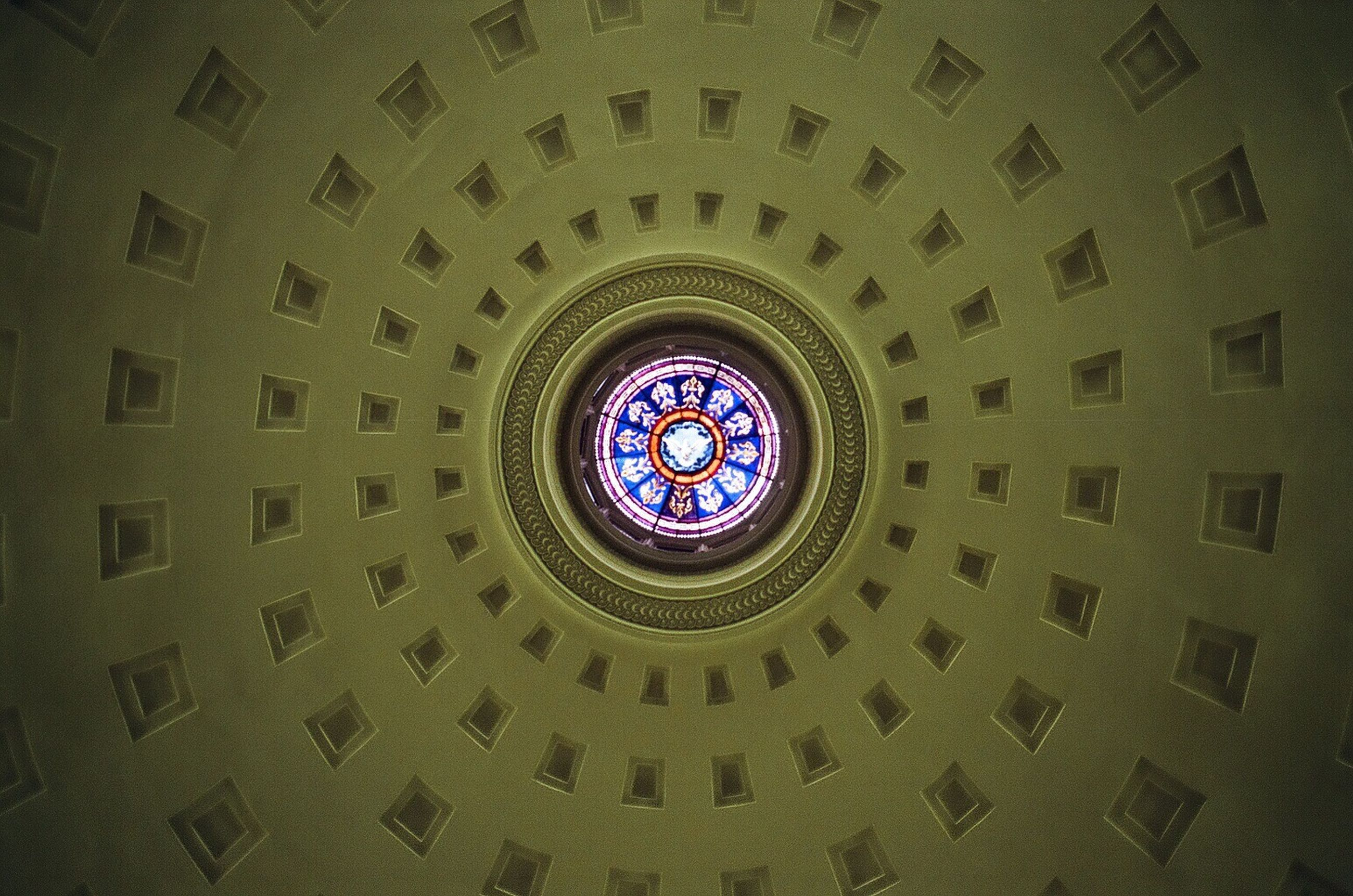 indoors, architecture, circle, ceiling, low angle view, built structure, clock, pattern, time, directly below, full frame, design, geometric shape, glass - material, backgrounds, architectural feature, arch, window, skylight, no people