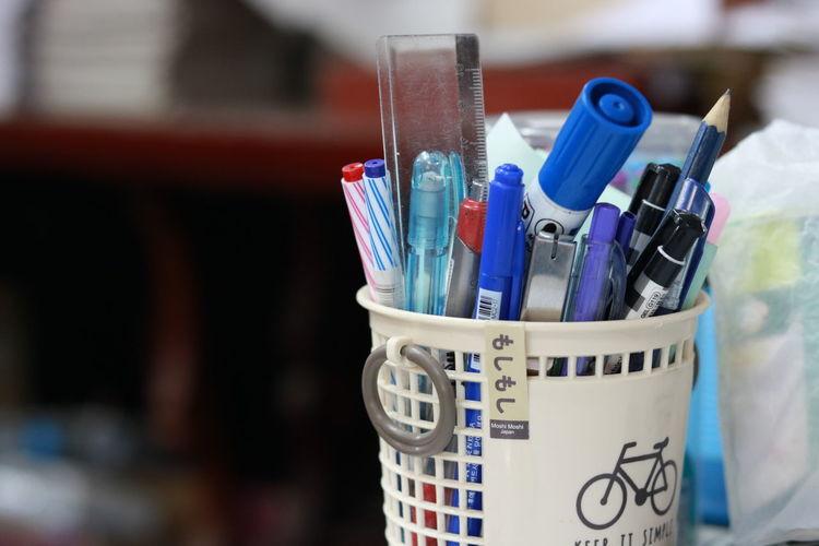 Close-up of pens in desk organizer