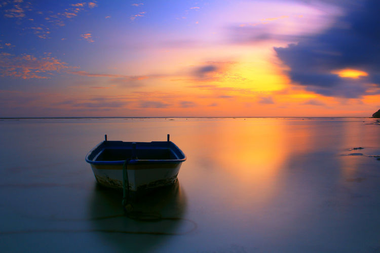 Boat In Sea Against Sky During Sunset