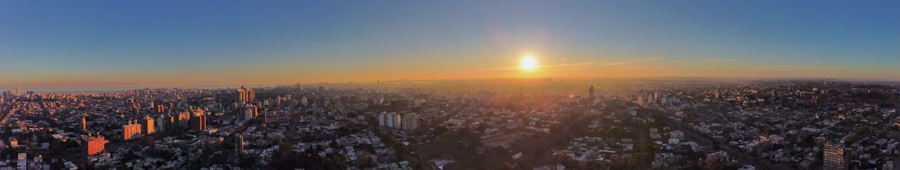 High angle view of city against sky during sunset