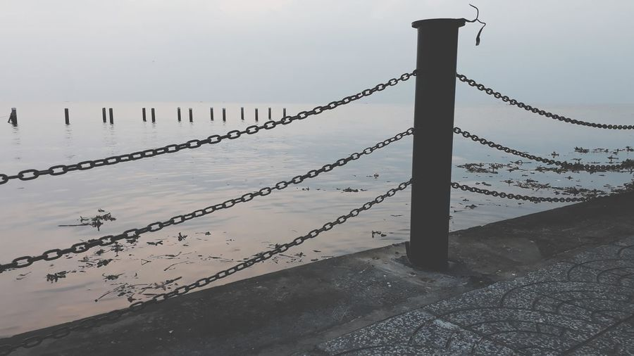 Beach Outdoors Wooden Post Barbed Wire No People Day Water Rural Scene Winter Beauty In Nature Cold Temperature Horizon Over Water Landscape