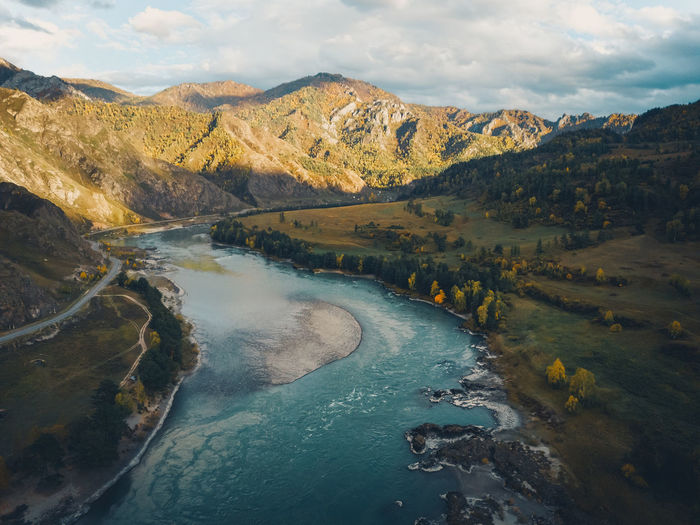 Aerial view of panoramic autumn mountain landscape with river. drone shot