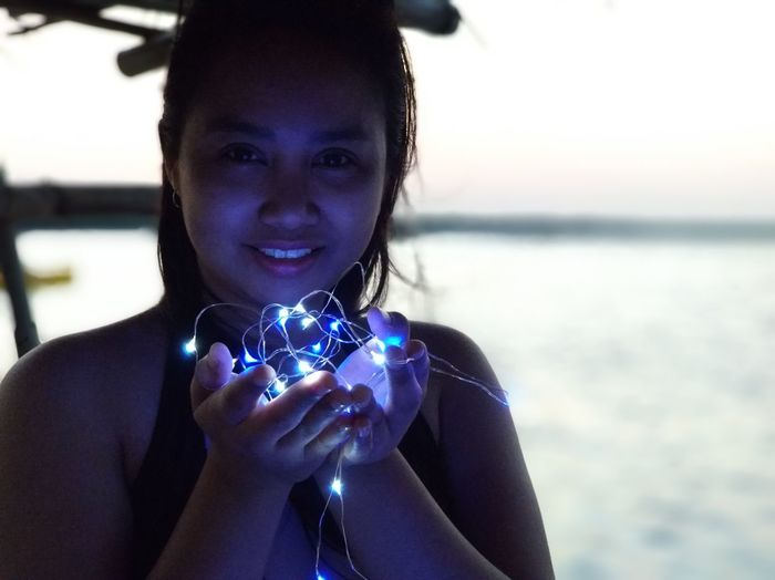 Tiny lights.. Tondolbeach Tondolbeachandapangasinan Andapangasinan Beachbreak Beachvacation Vacationbreak Summerfeels Summer2018 Travel Travelpamore2018 Ianielle2018 Portrait Smiling Looking At Camera Beach Happiness Water Holding Headshot Front View Sea