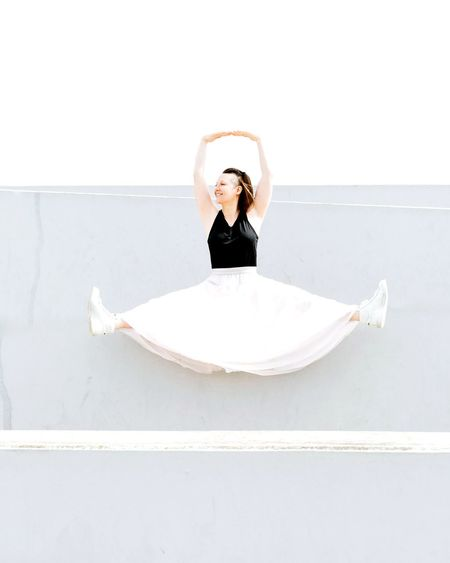 Flying high Jump Jumping Flying High White Color Outside Photography Fashion Photography Fashion&love&beauty Fashion Stories Young Women Women Beauty Females Portrait Stunt Energetic Mid-air