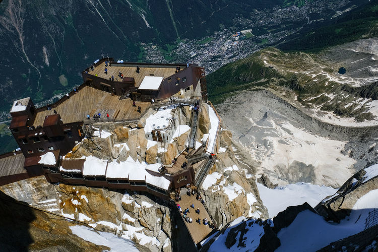 High angle view of snow covered buildings and mountains