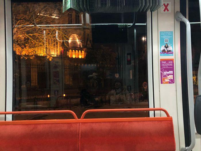Reflection of illuminated building on glass window