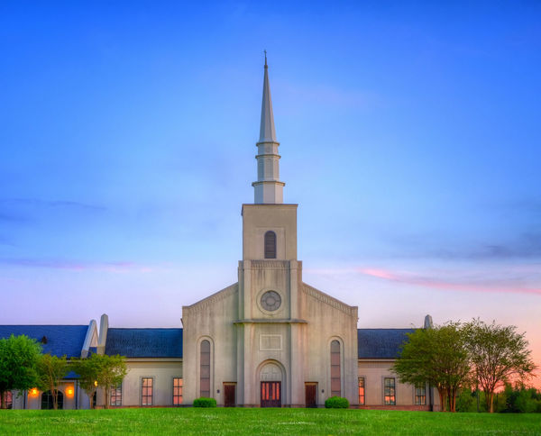Young Meadows Presbyterian Church in Montgomery, Alabama, at sunset. Alabama Architecture Blue Building Exterior Built Structure Church Dusk Montgomery Place Of Worship Religion Sky South Southern Spire  Sunset Tranquil Scene