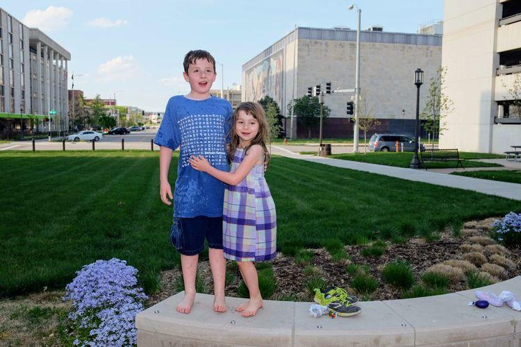 Portrait Of Siblings Standing Against Nebraska State Capitol Building
