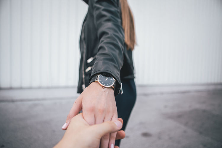 Portrait of Young Woman holding boyfriend hand in the urban city One Person Real People Hand Human Hand Human Body Part Lifestyles Focus On Foreground Body Part Day Adult Leisure Activity Women Wristwatch Watch Fashion Midsection Outdoors Human Leg Black Color Fashion Blogger Urban Urbanphotography City Ljubljana Slovenia Portrait Portrait Of A Woman Woman Young Adult Young Women Casual Clothing Casual Look