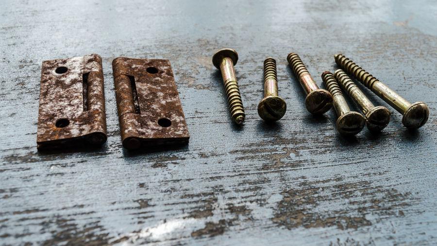 High angle view of rusty metal on table