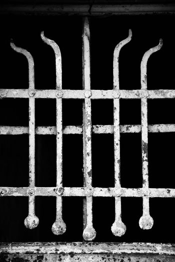Close-up of metal grate against building