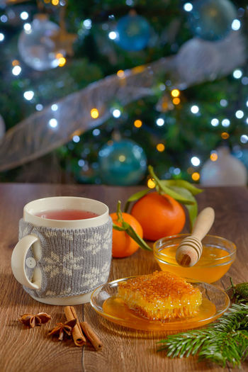 Close-up of hot drink and christmas decorations