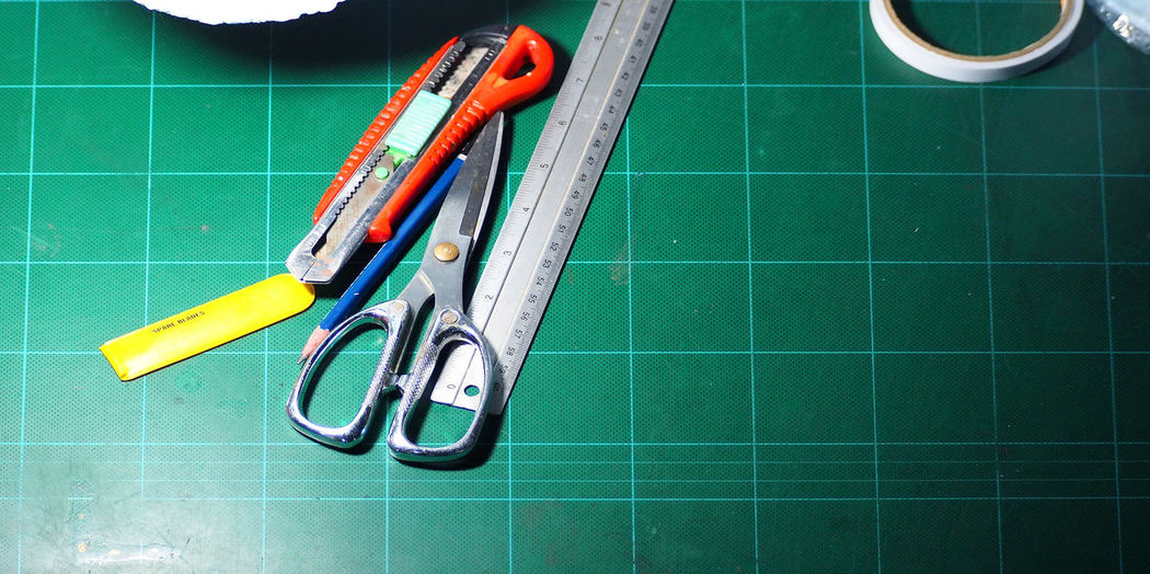 Scissor and cutter and ruler and pencil and blades on the green cutting mat and top view angle camera. Tile Indoors  Flooring No People Still Life Tiled Floor Equipment Close-up Multi Colored Work Tool Choice High Angle View Bathroom Sport Pen Domestic Bathroom Variation Paper Ruler Scissor And Cutter And Ruler And Pencil And Blades On The Green Cutting Mat And Top View Angle Camera. Mat; Cutting; Scissors; Cutter; Ruler; Background; Green; Paper; White; Craft; Office; Cut; Equipment; Grid; School; Scale; Tools; Design; Measure; Pencil; Board; Stationery; Supplies; Blades; Tape; Education; Tool; Sheet; Measurement; Instruments; Glue;