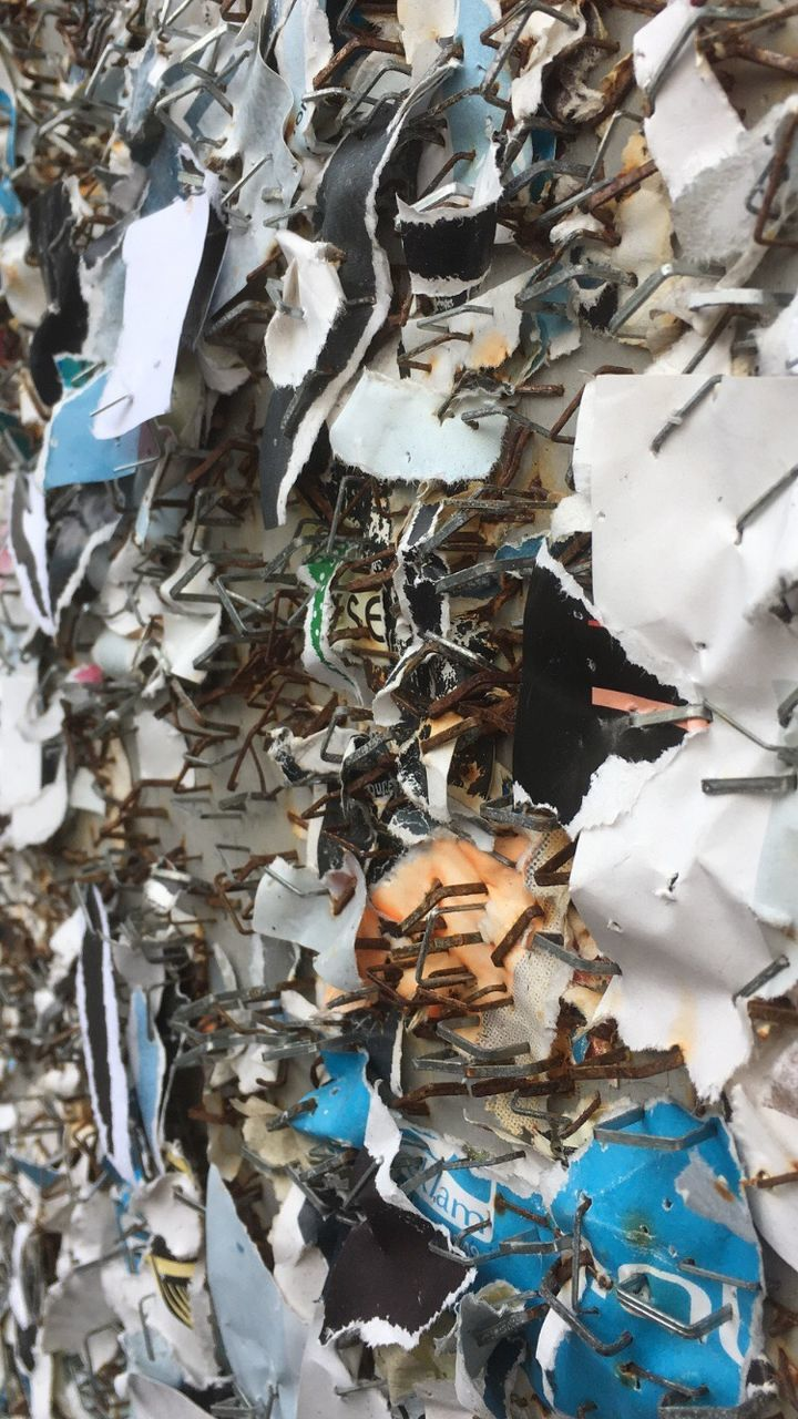 large group of objects, garbage, no people, paper, close-up, indoors, day
