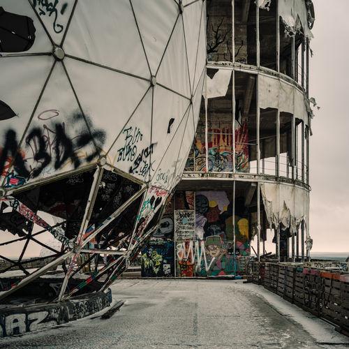 Decaying NSA listening station at Teufelsberg, Berlin Architecture Art Day Decay Framework Graffiti Graffiti Art Lost Places No People NSA Outdoors Radar Radar Station Radome Stages Streetart Structure Teufelsberg View Weathering