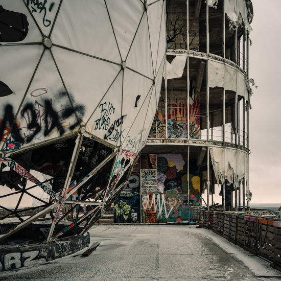 Decaying NSA listening station at Teufelsberg, Berlin Architecture Art Day Decay Framework Graffiti Graffiti Art Lost Places No People NSA Outdoors Radar Radar Station Radome Stages Streetart Structure Teufelsberg View Weathering