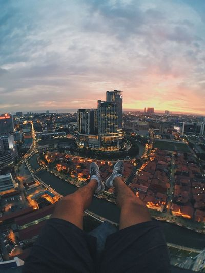 Beautiful day ends beautifully Architecturelovers Sky Sunset Rooftop Melaka Malaysia Architecture Cityscape Building Exterior Built Structure One Person Real People City Urban Skyline Skyscraper Cloud - Sky Outdoors Modern Sky EyeEmNewHere EyeEm Ready