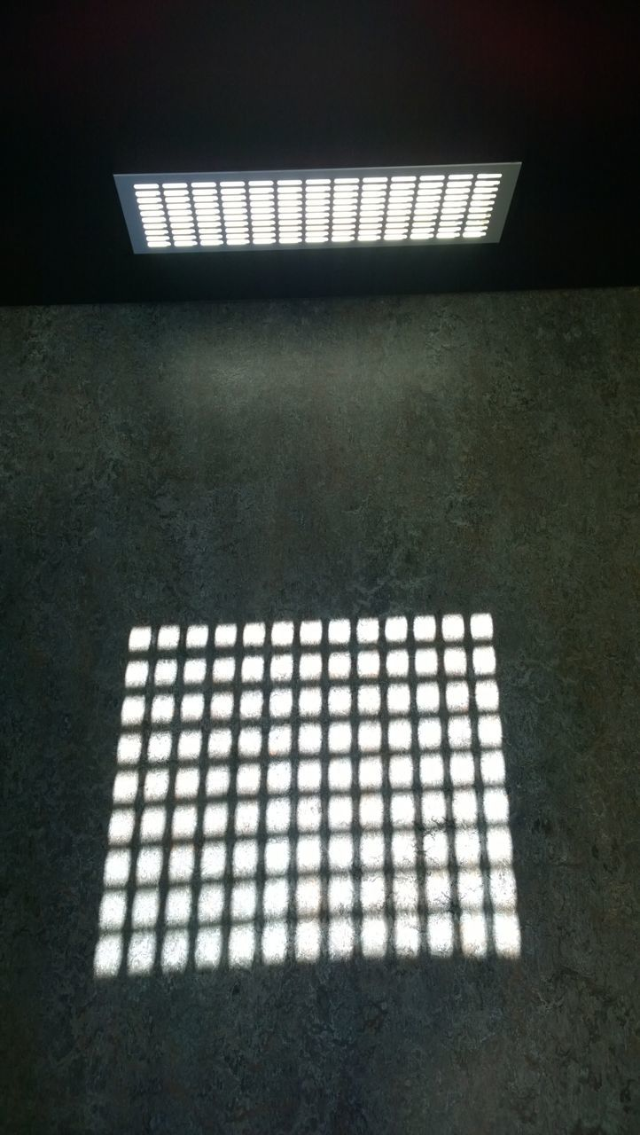 Low Angle View Of Skylight With Shadow On Wall