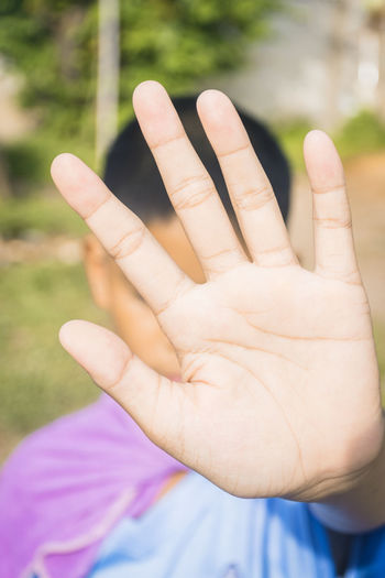 Close-up of human hand against blurred background
