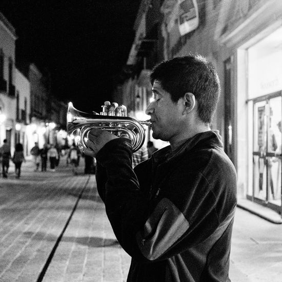 24 Hours 24hourproject Artist Bw Casual Clothing City City Life Illuminated Leisure Activity Lifestyles Music Musician Night Outdoors Trumpet Trumpet Flower