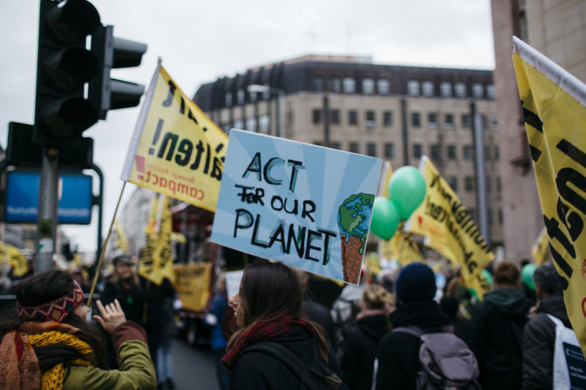 """Act for our planet"" Demonstration Global Climate March! Arrow Symbol Banner Berlin Capital Letter Climate Communication Demonstration Direction Directional Sign Global Climate Guidance Information Information Sign Non-western Script Number People Planet Road Sign Sign Street Street Photography Streetphotography Text Warning Sign Western Script"