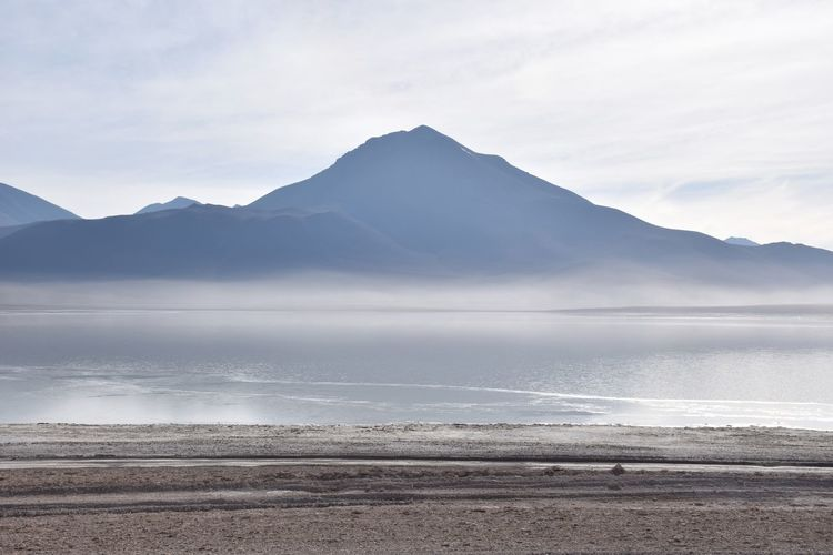 Beauty In Nature Blue Day Dust Environment Fog Idyllic Lake Land Landscape Mountain Mountain Range Nature No People Non-urban Scene Outdoors Salt Flat Scenics - Nature Sea Sky Tranquil Scene Tranquility Water Waterfront