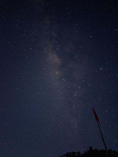 Low angle view of stars in sky at night