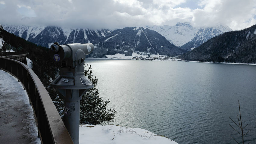 Achensee Beauty In Nature Coin-operated Binoculars Cold Temperature Day Frozen Lake Landmark Landscape Mountain Mountain Range Nature No People Outdoors Scenics Sky Snow Snowcapped Mountain Tourism Tranquil Scene Tranquility Water Weather Winter