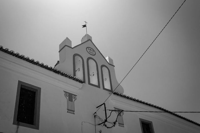 Sunlight Architecture Blackandwhite Photography Building Exterior Built Structure Church Architecture Clear Sky Cross Day Light And Shadow Lines And Shapes Low Angle View No People Outdoors Place Of Worship Religion Sky Spirituality Whitewashed