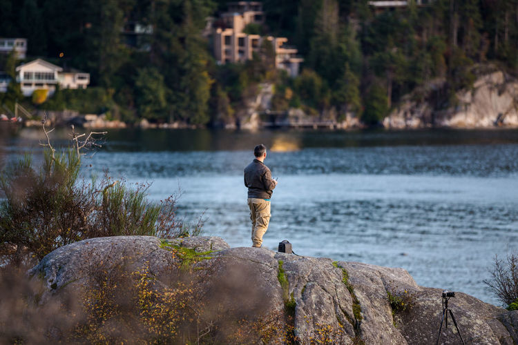 Man standing on rock at beach