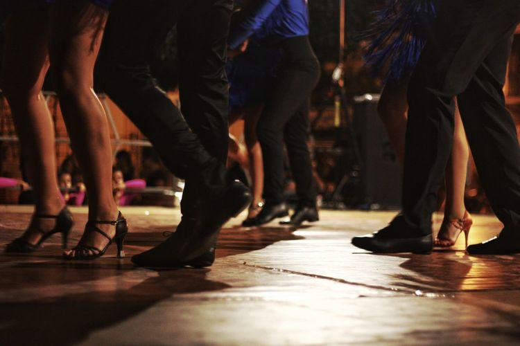 Low Section Human Leg Performance Arts Culture And Entertainment Large Group Of People Adult People Music Performing Arts Event Night Adults Only Performance Group Dancers