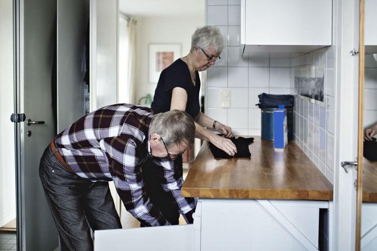 Men looking at camera at home
