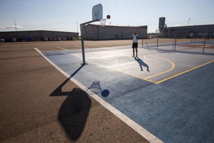 Full length of man playing basketball