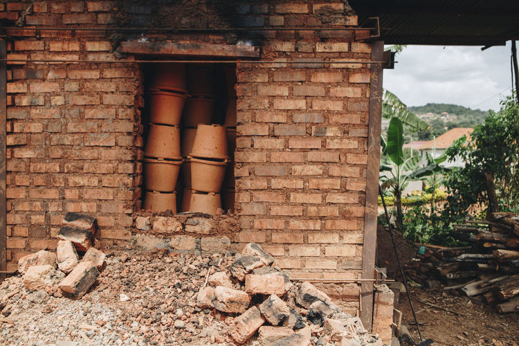 Africa African Brick Wall Bricks Building Exterior Built Structure Business Ceramic Clay Day Entrepreneurship Factory Firing  Kiln Manufacturing No People Outdoors Oven Plant Pots Pottery Social Business Stacked Terracotta Workshop