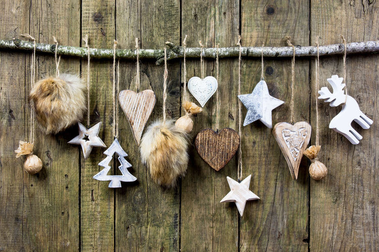 Christmas decorations on wooden wall