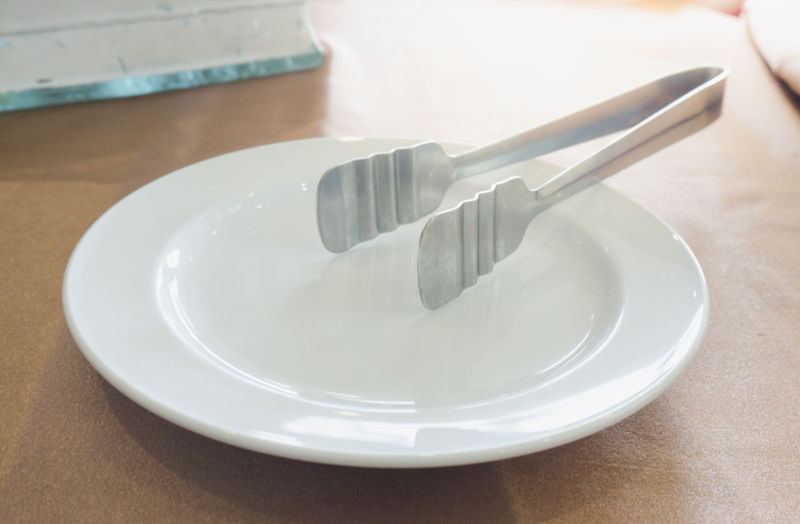 Clean Close-up Crockery Eating Utensil Empty Empty Plate Focus On Foreground Food Food And Drink Fork High Angle View Household Equipment Indoors  Kitchen Utensil No People Plate Silver Colored Silverware  Spoon Still Life Table White Color