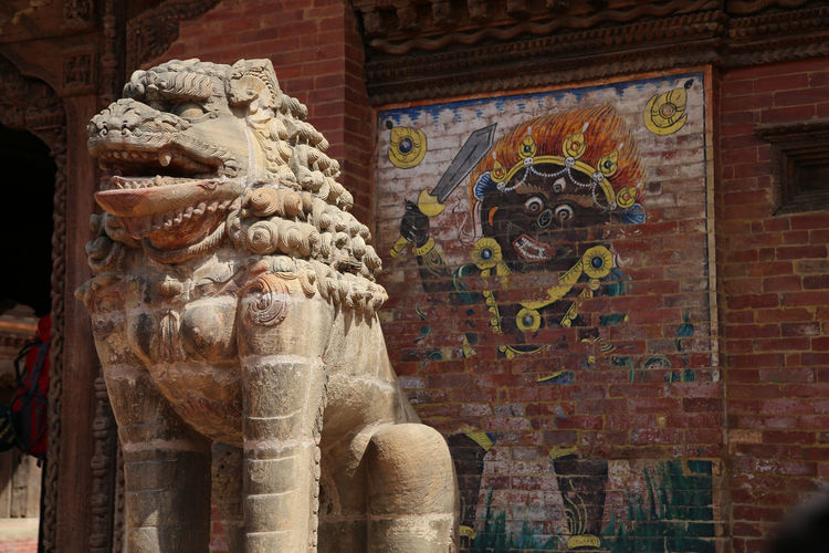 Lion statue outside buddhist temple