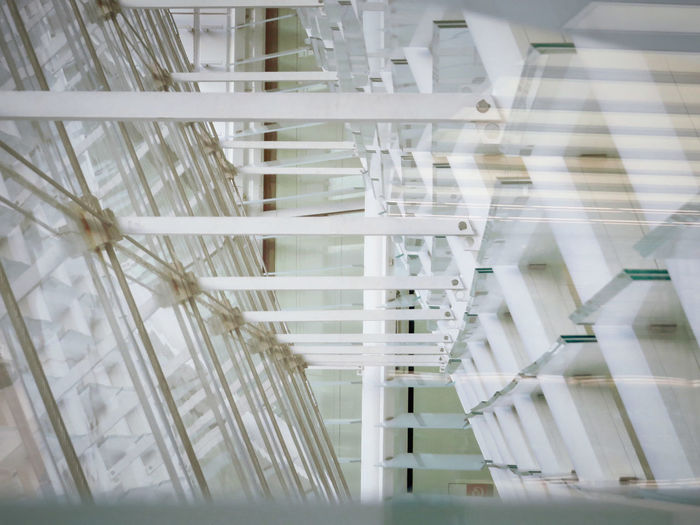 Architecture Built Structure Complex Structure Connections Crossing Lines Detail Glass And Metal Indoors  Intersecting Lines Low Angle View Modern Modern Building No People Nodes White Color The Graphic City