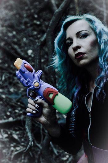 Portrait of woman holding squirt gun